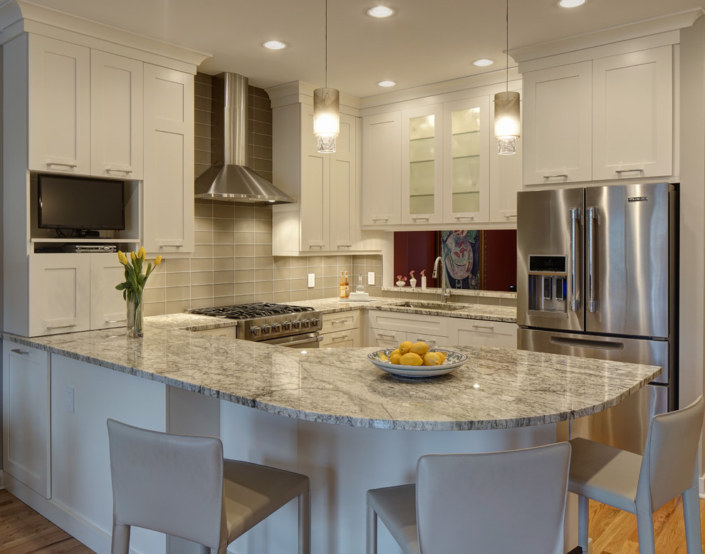 Small transitional u-shaped light wood floor open concept kitchen photo in Chicago with a single-bowl sink, shaker cabinets, white cabinets, granite countertops, glass tile backsplash, stainless steel appliances, a peninsula and gray countertops