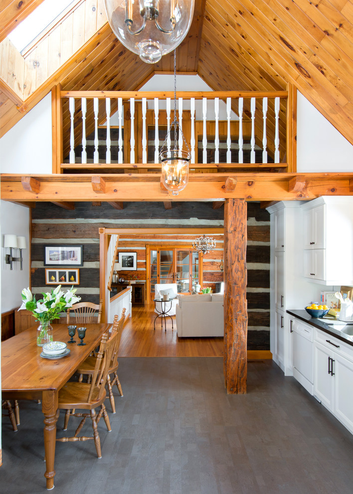 Inspiration for a rustic l-shaped gray floor eat-in kitchen remodel in Toronto with recessed-panel cabinets, white cabinets and white appliances