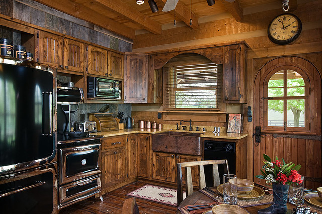 Log home with barn wood and western decor traditional for Barn kitchen designs