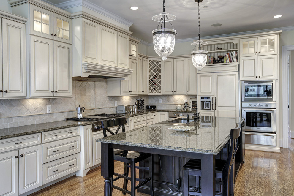Kitchen - traditional kitchen idea in DC Metro with subway tile backsplash and stainless steel appliances