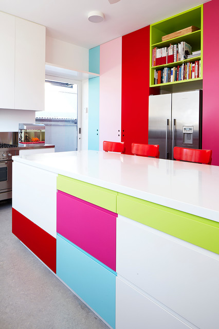 Example of a large trendy kitchen design in Sydney with flat-panel cabinets, stainless steel appliances and an island