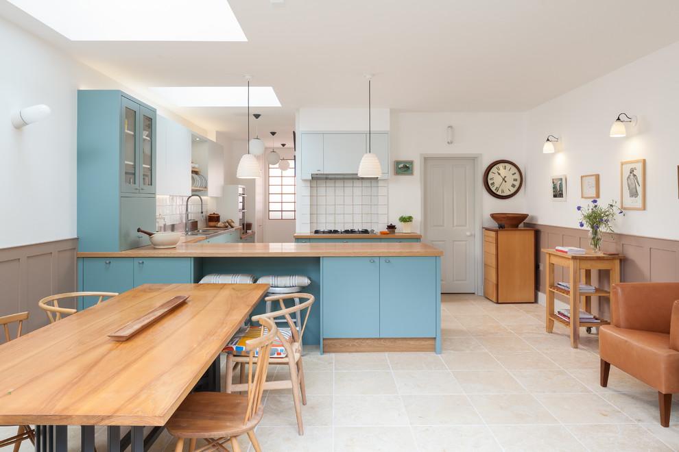 Esempio di una cucina contemporanea con ante blu