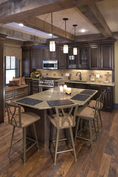 A beautiful rich and warm traditional styled kitchen design with Dura Supreme Cabinetry by Bob Michels Construction, Inc.