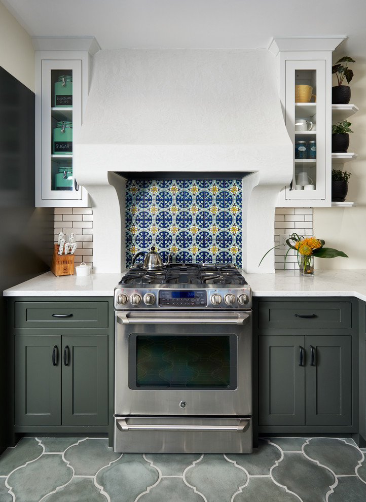 Inspiration for a mid-sized mediterranean gray floor kitchen remodel in Minneapolis with shaker cabinets, quartz countertops, multicolored backsplash, stainless steel appliances and gray cabinets