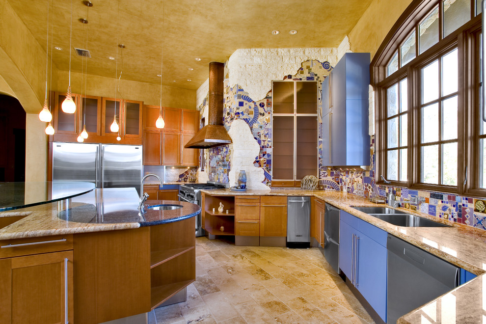 Example of an eclectic kitchen design in Austin with mosaic tile backsplash, stainless steel appliances, multicolored backsplash, a double-bowl sink and medium tone wood cabinets