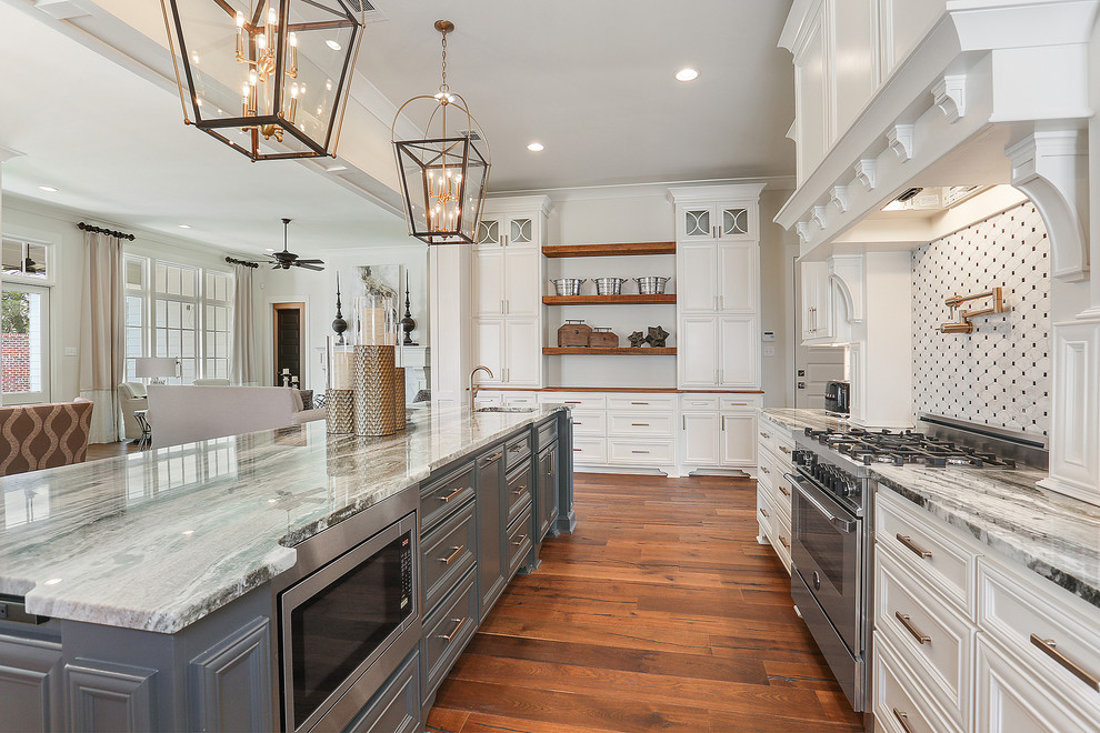 Large cottage single-wall dark wood floor and brown floor eat-in kitchen photo in New Orleans with an undermount sink, recessed-panel cabinets, white cabinets, granite countertops, white backsplash, ceramic backsplash, stainless steel appliances, an island and gray countertops