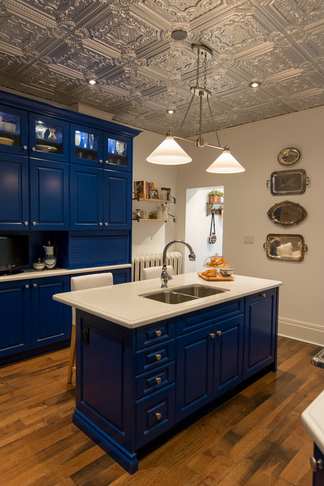 Inspiration for a farmhouse enclosed kitchen remodel in Toronto with a double-bowl sink, raised-panel cabinets and blue cabinets