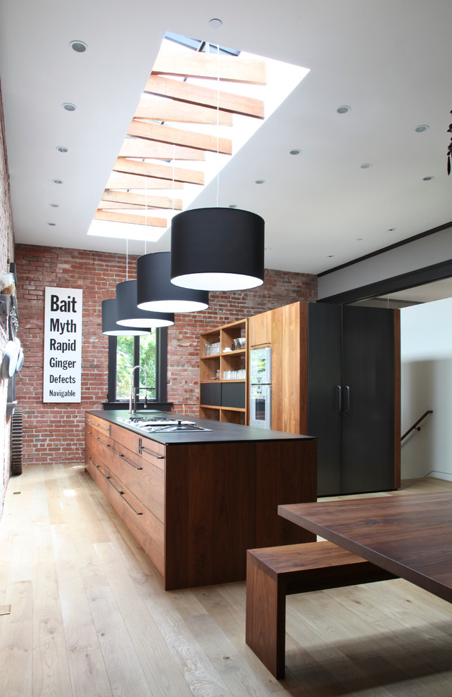 Trendy galley kitchen photo in San Francisco with flat-panel cabinets and medium tone wood cabinets