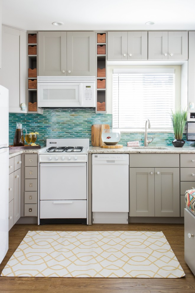 Inspiration for a small coastal l-shaped vinyl floor and brown floor eat-in kitchen remodel in San Diego with an undermount sink, shaker cabinets, gray cabinets, granite countertops, blue backsplash, white appliances, glass tile backsplash and gray countertops