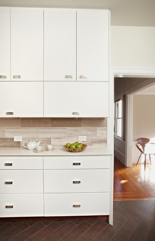 Enclosed kitchen - contemporary enclosed kitchen idea in San Francisco with flat-panel cabinets, white cabinets, quartz countertops, gray backsplash and stone tile backsplash