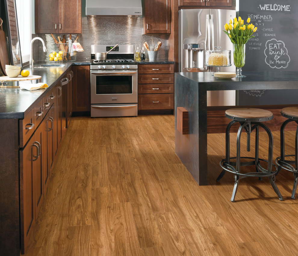 Example of a large transitional u-shaped medium tone wood floor and brown floor open concept kitchen design in Other with shaker cabinets, medium tone wood cabinets, soapstone countertops, metallic backsplash, matchstick tile backsplash, stainless steel appliances, an island and an undermount sink
