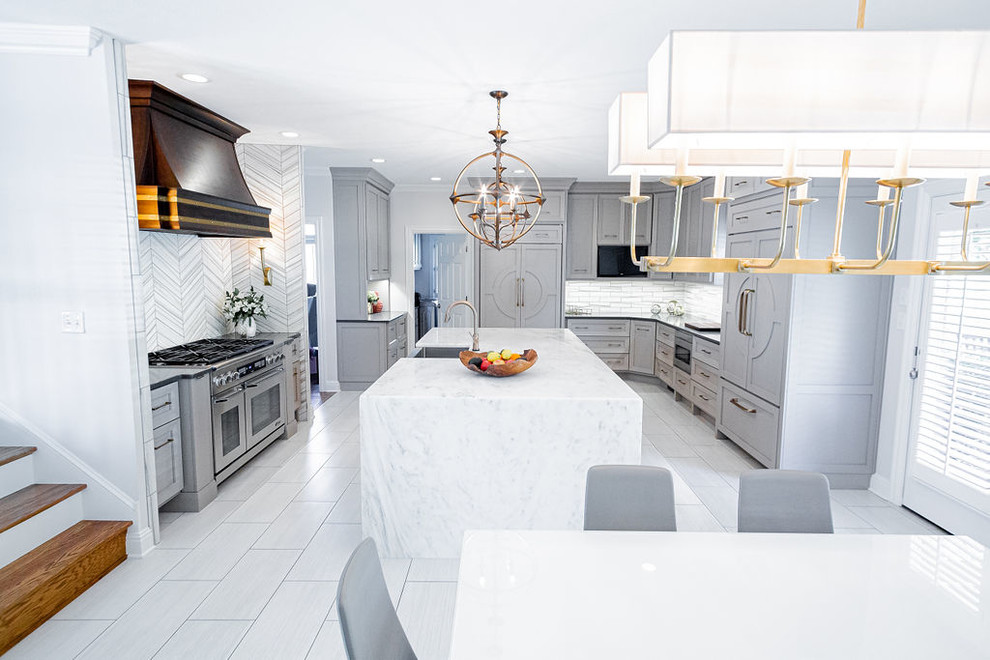 Inspiration for a large modern u-shaped porcelain tile and gray floor kitchen remodel in Other with a farmhouse sink, marble countertops, gray backsplash, marble backsplash, stainless steel appliances, an island and multicolored countertops