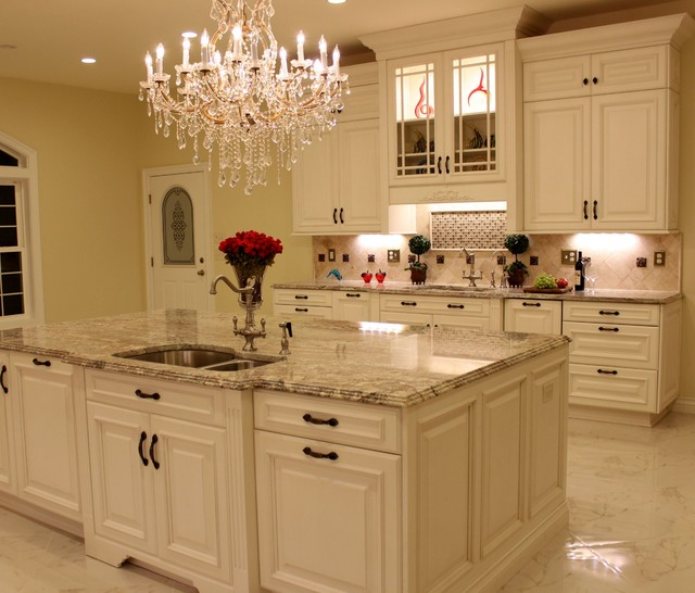 Luxurious Kitchen w Antique White Cabinetry & Sienna Bordeaux Granite