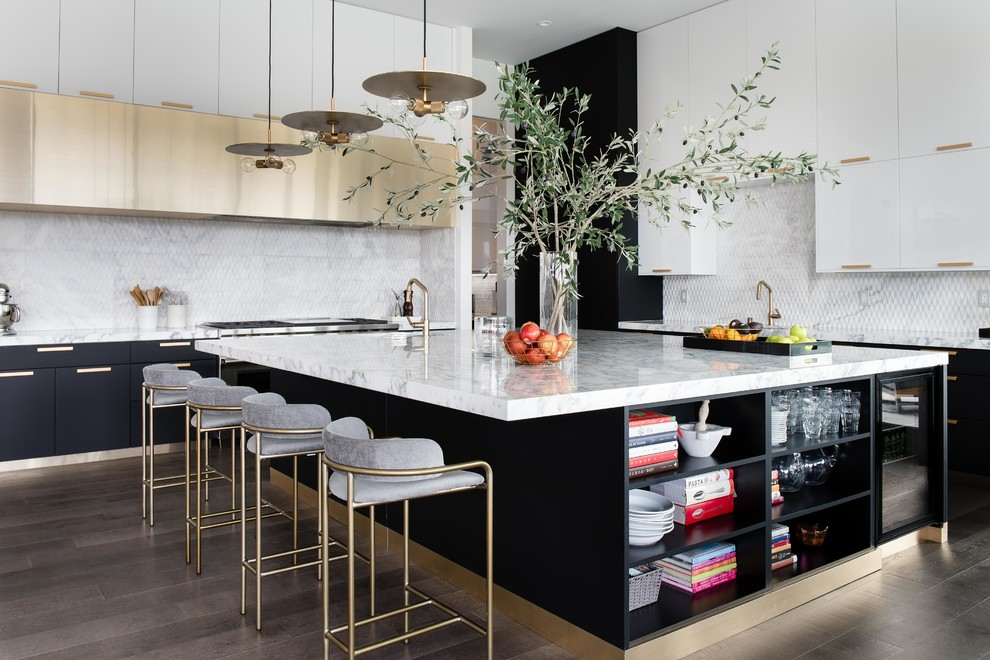 Large trendy dark wood floor and brown floor kitchen photo in Las Vegas with flat-panel cabinets, an island, marble countertops, white backsplash and white countertops