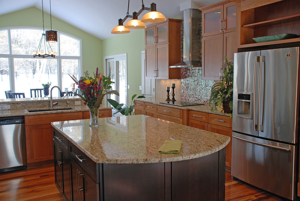 Example of a trendy kitchen design in Detroit with stainless steel appliances, granite countertops and mosaic tile backsplash
