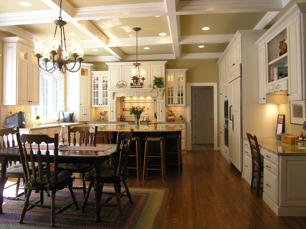 Elegant l-shaped eat-in kitchen photo in DC Metro with paneled appliances