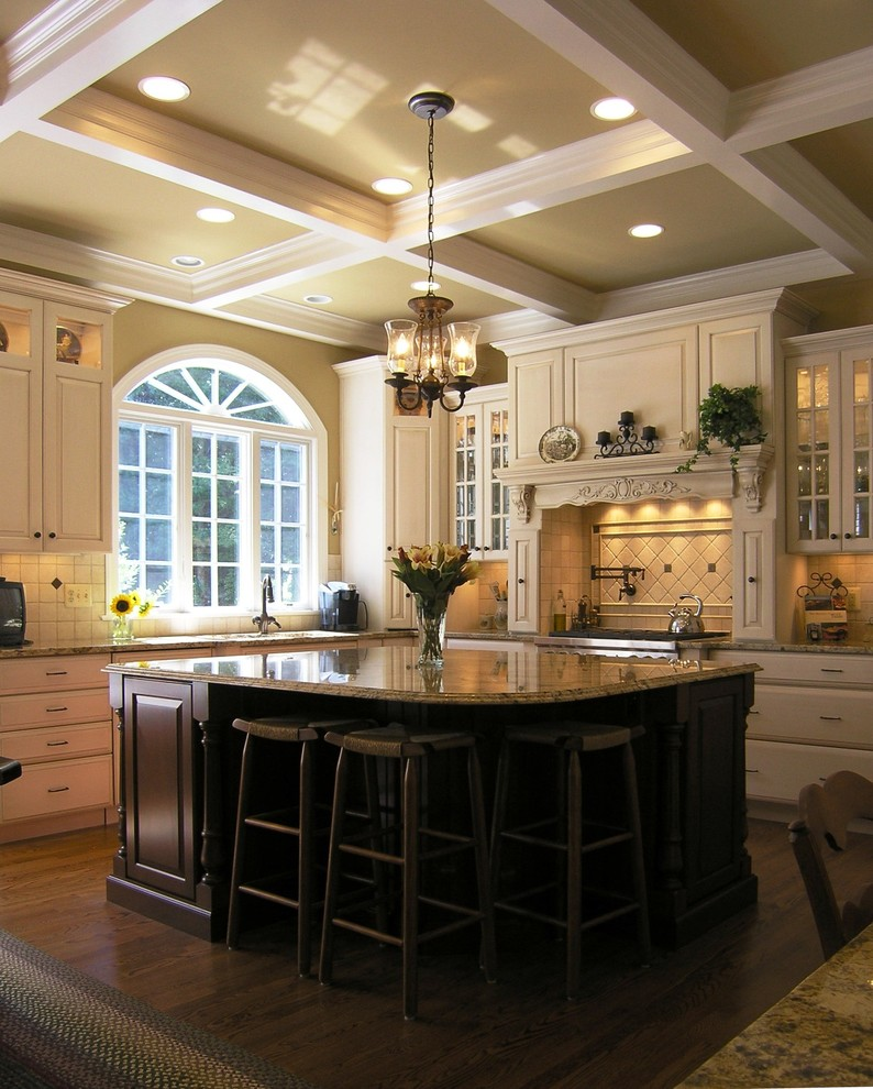 Example of a classic kitchen design in DC Metro with granite countertops