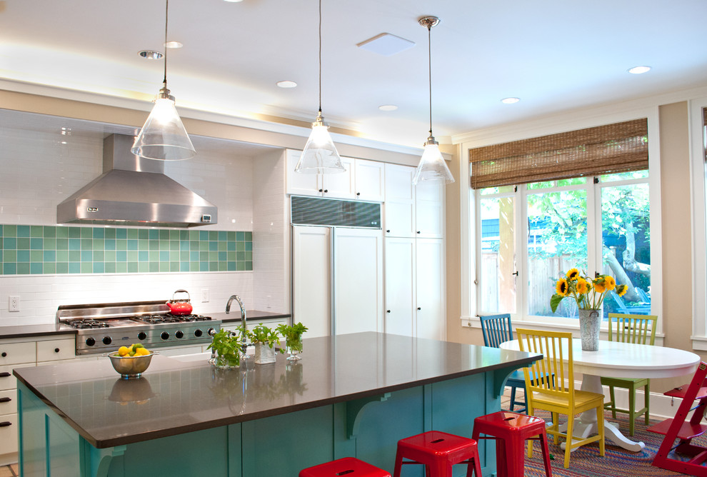 Inspiration for a large modern u-shaped terra-cotta tile and beige floor eat-in kitchen remodel in Seattle with a farmhouse sink, raised-panel cabinets, white cabinets, solid surface countertops, white backsplash, subway tile backsplash, stainless steel appliances and an island