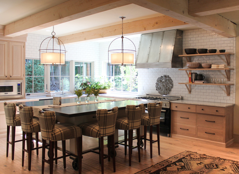Inspiration for a contemporary kitchen remodel in Portland Maine with subway tile backsplash, flat-panel cabinets, light wood cabinets, white backsplash and stainless steel appliances