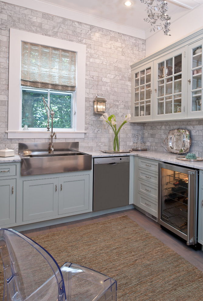 Enclosed kitchen - mid-sized traditional l-shaped light wood floor enclosed kitchen idea in New York with a farmhouse sink, beaded inset cabinets, blue cabinets, marble countertops, stainless steel appliances, gray backsplash, no island and marble backsplash