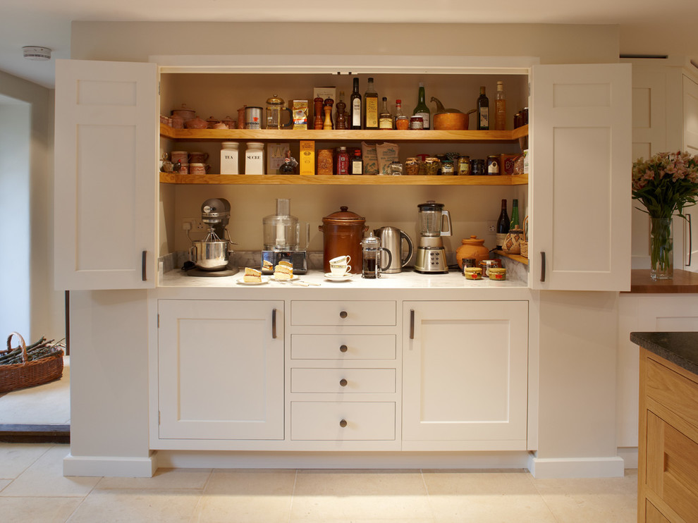 Kitchen pantry - large traditional limestone floor kitchen pantry idea in Surrey with shaker cabinets, white cabinets and marble countertops