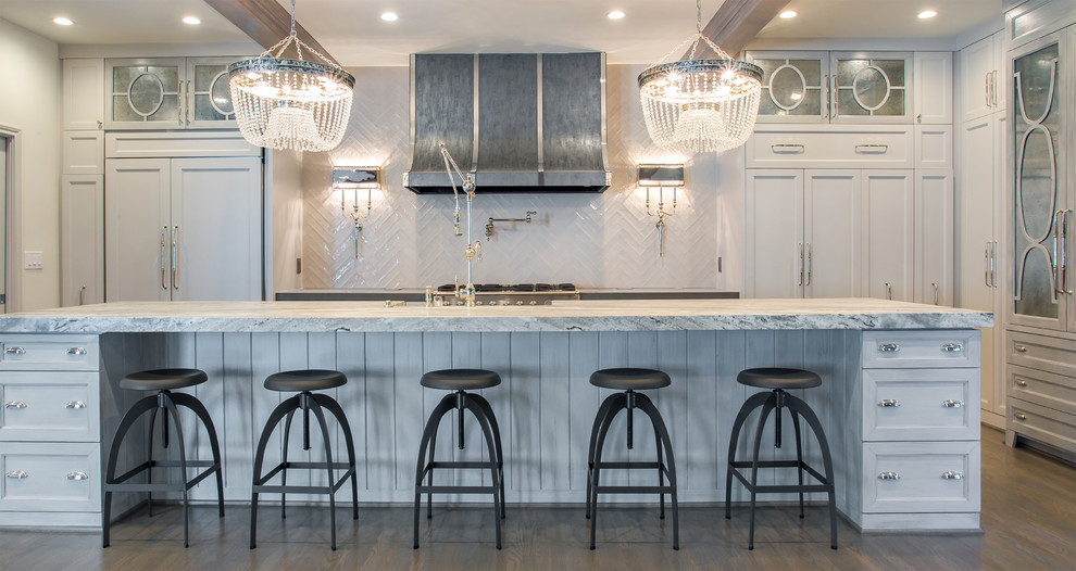 Eat-in kitchen - huge eclectic u-shaped light wood floor eat-in kitchen idea in Houston with a farmhouse sink, glass-front cabinets, white cabinets, white backsplash, porcelain backsplash, stainless steel appliances, an island and marble countertops