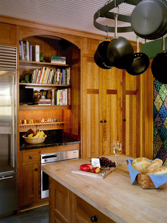 ... with medium tone wood cabinets, shaker cabinets and countertops
