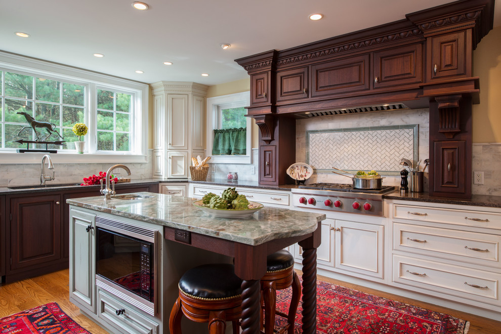 Elegant u-shaped medium tone wood floor eat-in kitchen photo in Boston with an undermount sink, beaded inset cabinets, white cabinets, granite countertops, multicolored backsplash, stainless steel appliances, subway tile backsplash and an island