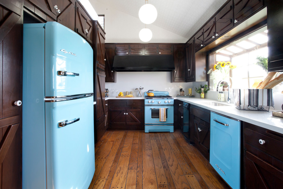Inspiration for a rustic u-shaped enclosed kitchen remodel in New York with dark wood cabinets, white backsplash and colored appliances