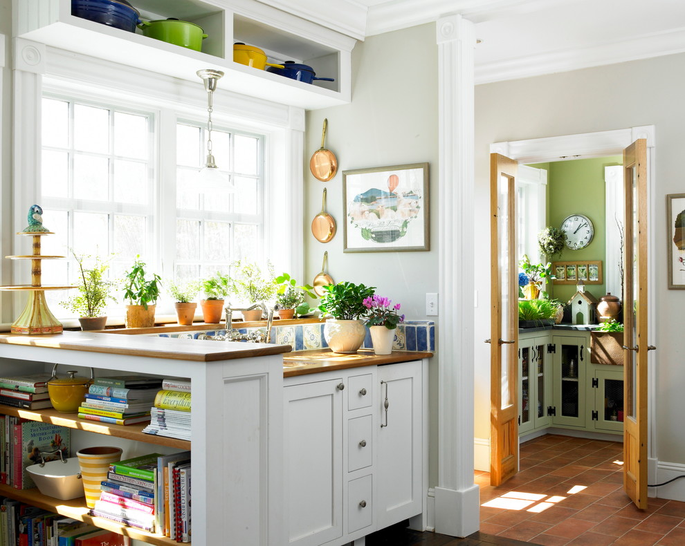 Cottage terra-cotta tile kitchen photo in New York with shaker cabinets, white cabinets, wood countertops and multicolored backsplash