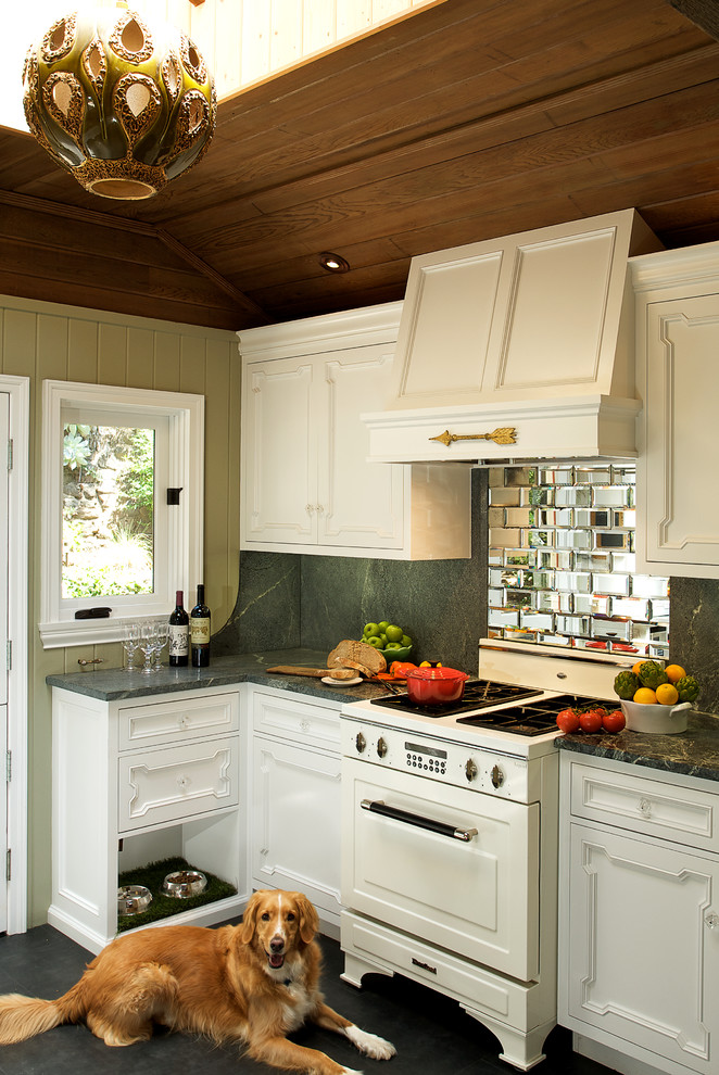 Kitchen - eclectic kitchen idea in Los Angeles with white appliances and mirror backsplash