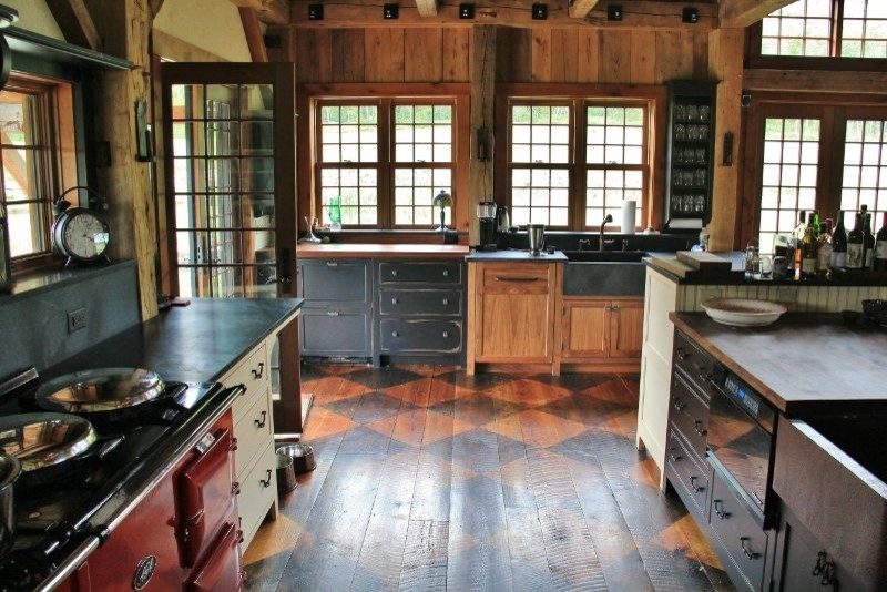 Design ideas for a traditional open plan kitchen in Burlington with a farmhouse sink, medium hardwood floors and an island.