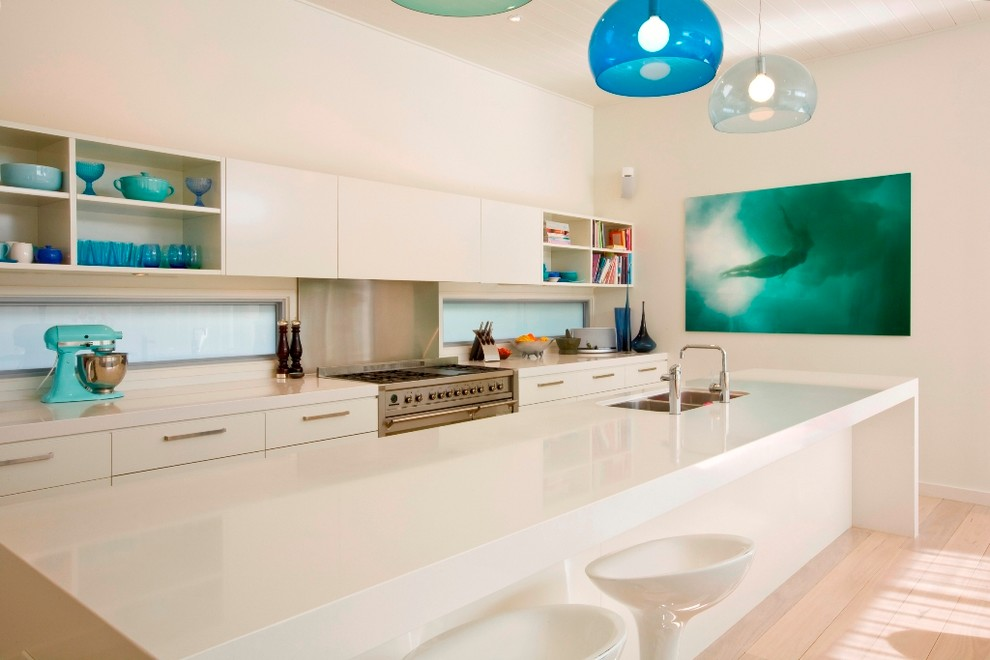 Trendy galley kitchen photo in Sydney with a double-bowl sink, flat-panel cabinets and white cabinets