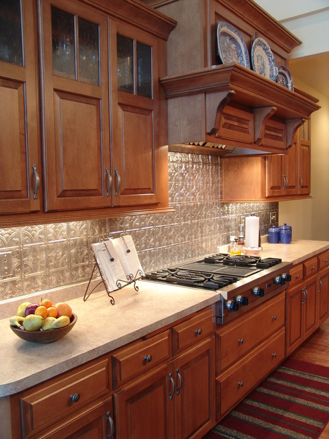 maple cabinets - tin backsplash traditional-kitchen