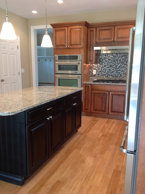 Maple glazed kitchen cabinets with black painted island