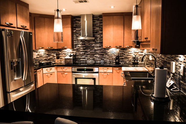Maple kitchen cabinets with black absolute granite countertops on Maple Cabinets With Black Countertops  id=51145