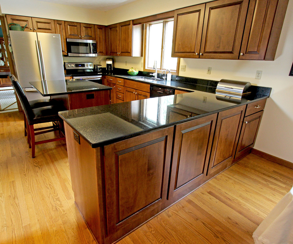 Maple Kitchen Cabinets with Black Pearl Granite ... on Maple Cabinets Black Countertops  id=36433
