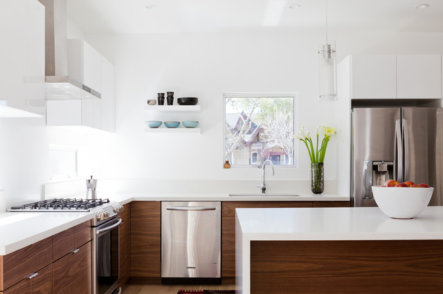 Example of a trendy kitchen design in Los Angeles with flat-panel cabinets, medium tone wood cabinets and quartzite countertops
