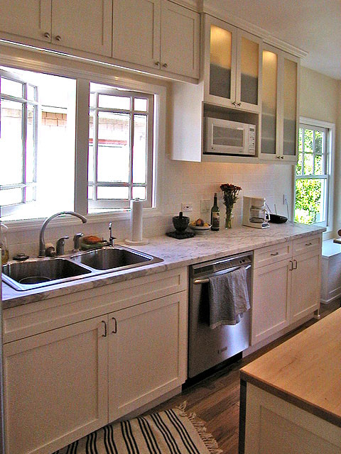 Marble Counters, Painted Maple Cabinets. Traditional Kitchen