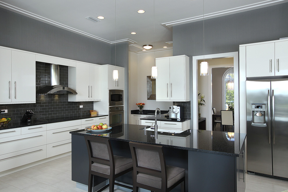 Mid-sized trendy u-shaped porcelain tile kitchen photo in Miami with stainless steel appliances, a farmhouse sink, flat-panel cabinets, white cabinets, granite countertops, black backsplash, subway tile backsplash and an island