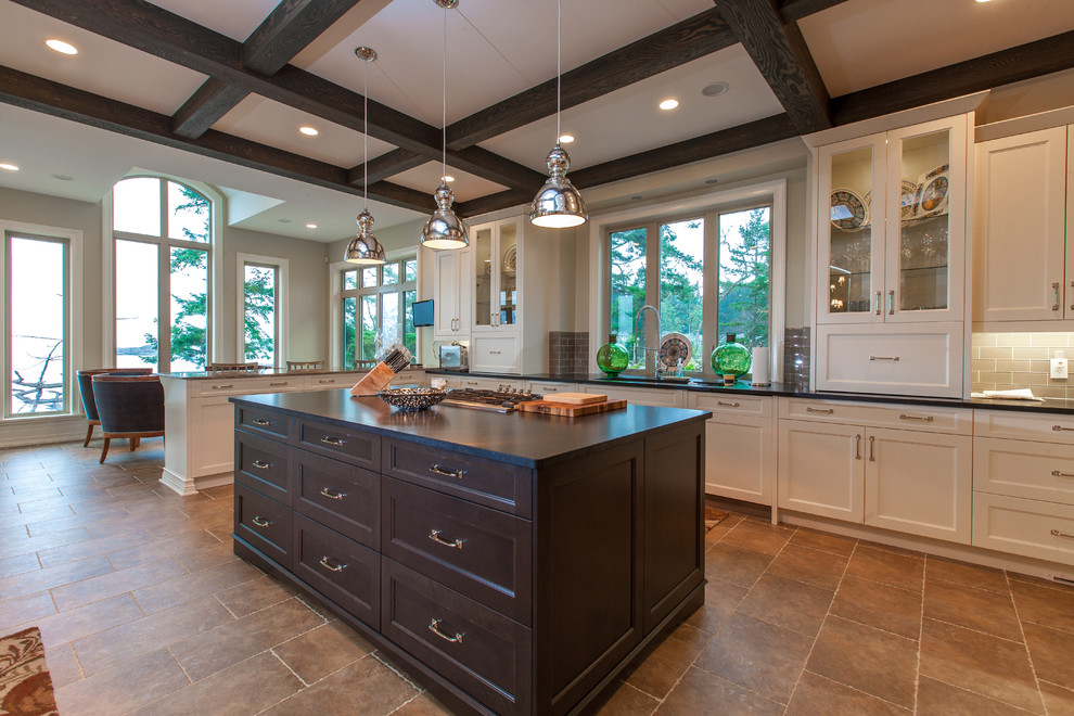 Inspiration for a timeless kitchen remodel in Vancouver with glass-front cabinets, white cabinets, gray backsplash and subway tile backsplash