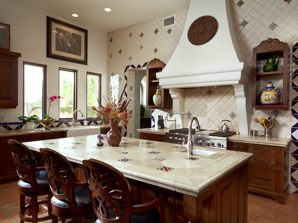 Example of a tuscan kitchen design in Austin with a farmhouse sink