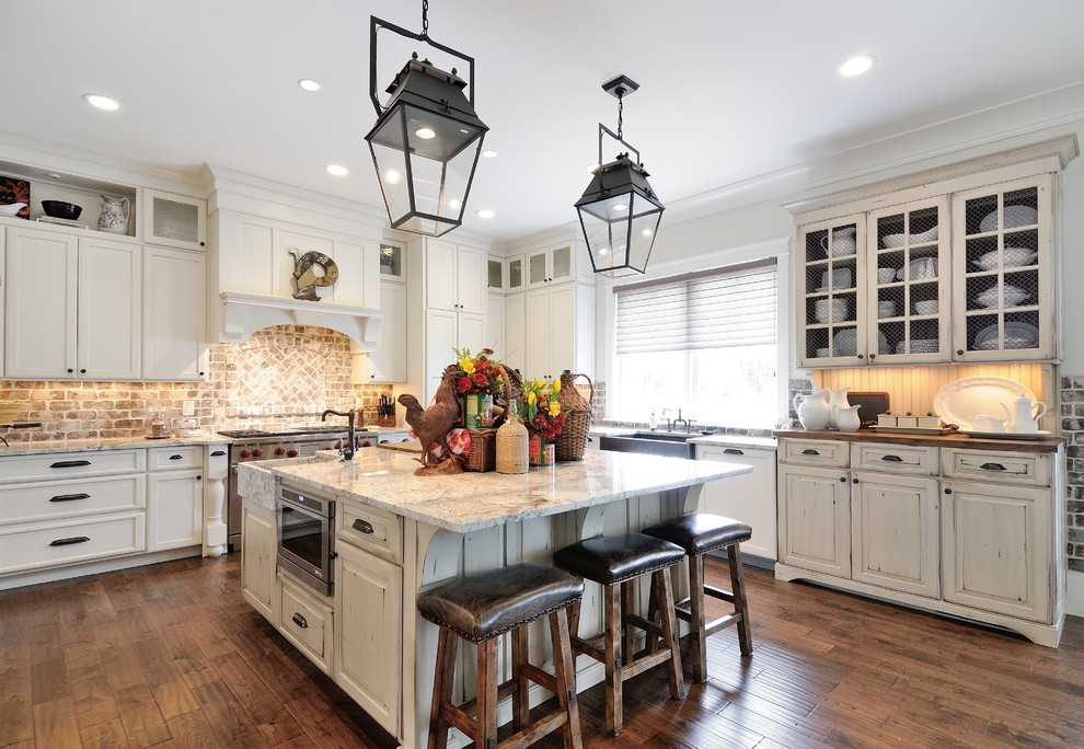 Kitchen - traditional kitchen idea in Atlanta with distressed cabinets