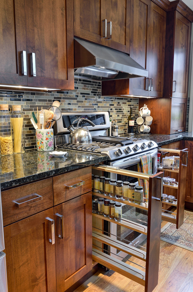 Inspiration for a timeless kitchen remodel in Atlanta with shaker cabinets, dark wood cabinets, multicolored backsplash, stainless steel appliances and black countertops