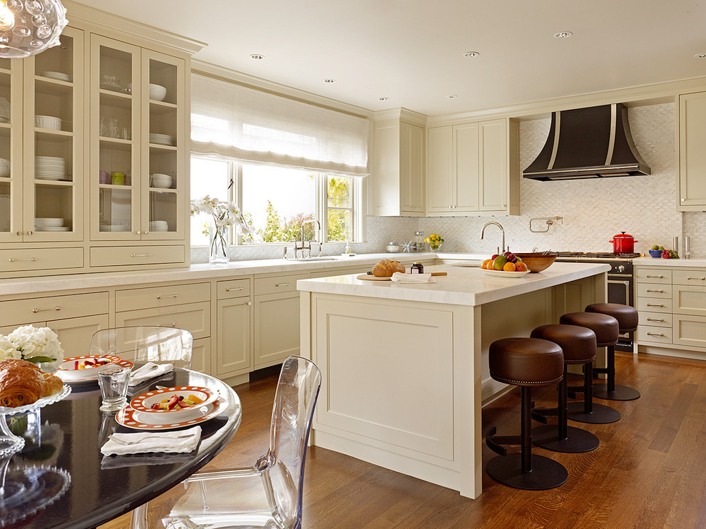 Example of a transitional eat-in kitchen design in San Francisco with shaker cabinets and beige cabinets