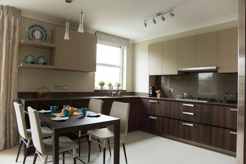 Example of a mid-sized trendy u-shaped ceramic tile eat-in kitchen design in London with an undermount sink, flat-panel cabinets, dark wood cabinets, quartz countertops, brown backsplash, stainless steel appliances and no island