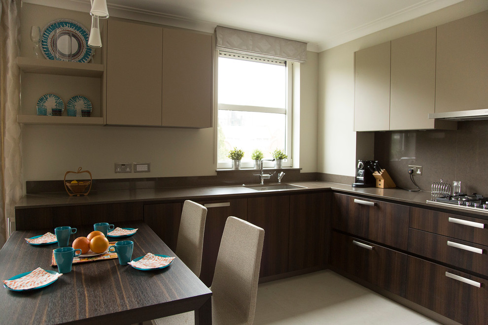 Eat-in kitchen - mid-sized contemporary u-shaped ceramic tile eat-in kitchen idea in London with an undermount sink, flat-panel cabinets, dark wood cabinets, quartz countertops, brown backsplash, stainless steel appliances and no island