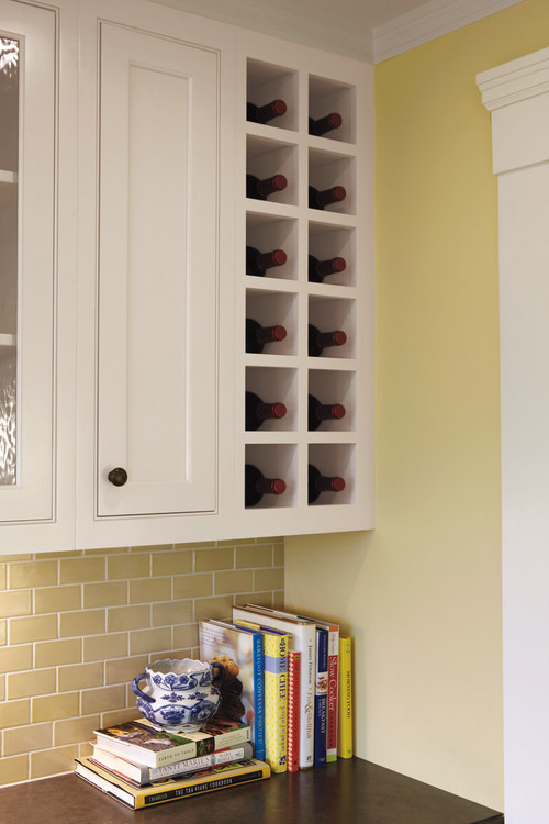 Wine bottles stored in a kitchen cupboard