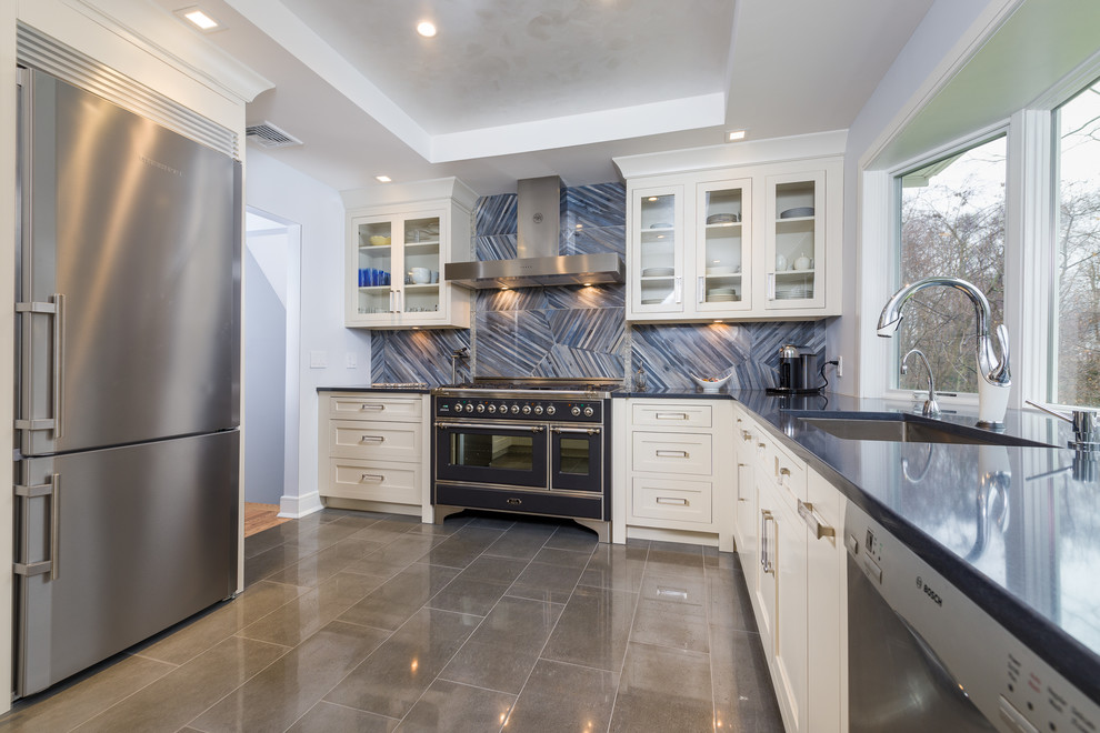 Inspiration for a mid-sized contemporary l-shaped porcelain tile eat-in kitchen remodel in New York with an undermount sink, recessed-panel cabinets, beige cabinets, quartz countertops, blue backsplash, porcelain backsplash, stainless steel appliances and a peninsula