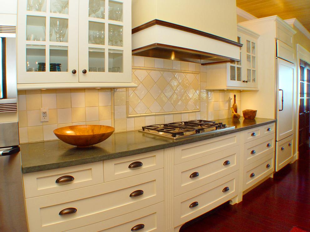 Island style kitchen photo in Hawaii with limestone countertops